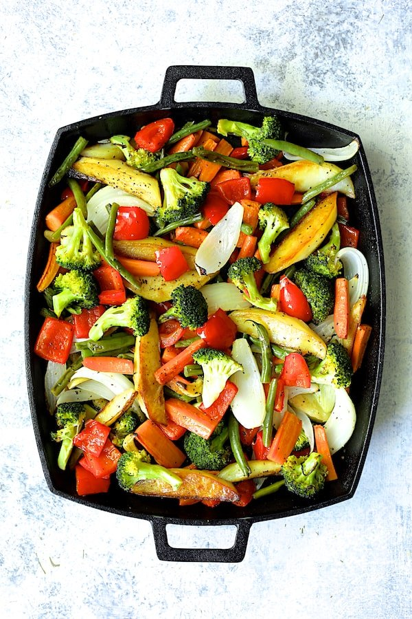 Overhead shot of finished roasted vegetables on cast iron pan