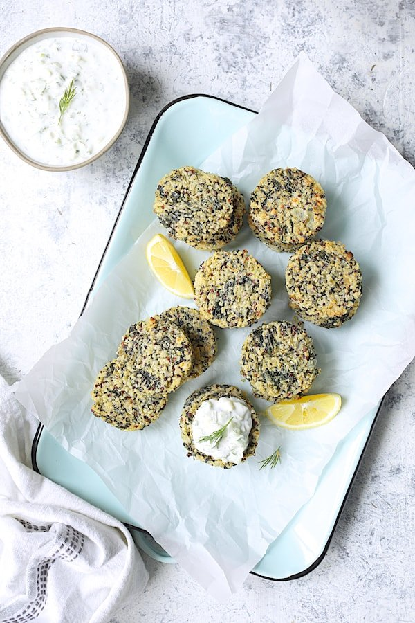 Greek Quinoa Cakes with Tzatziki - Overhead shot of quinoa cakes on light blue platter with tzatziki