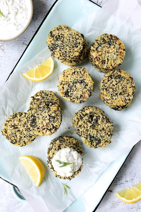Greek Quinoa Cakes with Tzatziki - Overhead hero shot of cakes garnished with lemon