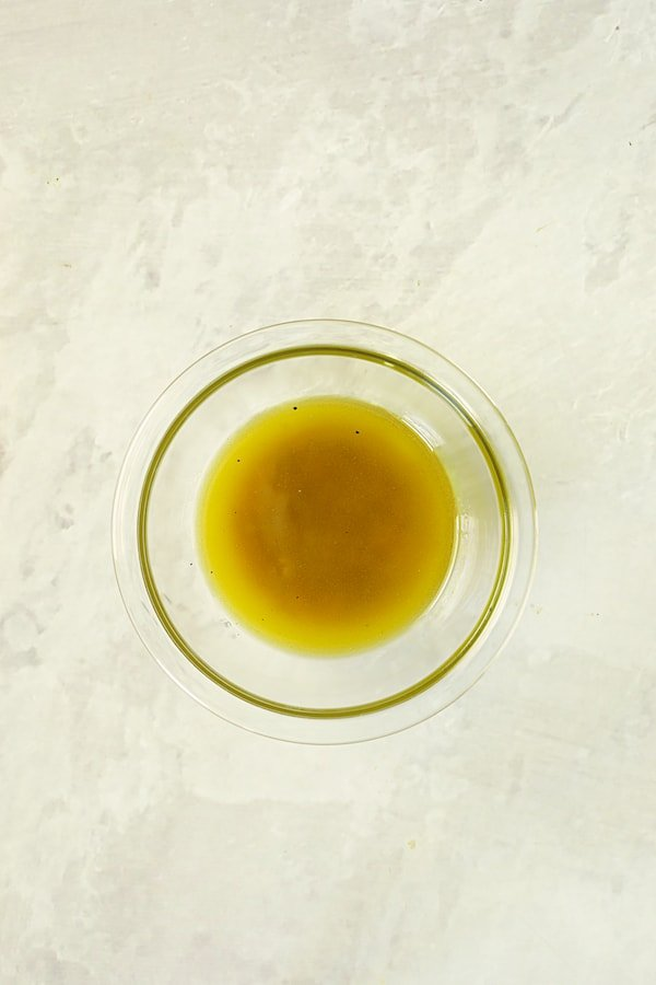 Overhead shot of vinaigrette in glass bowl