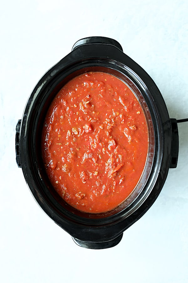 Overhead shot of sauce with tomatoes added