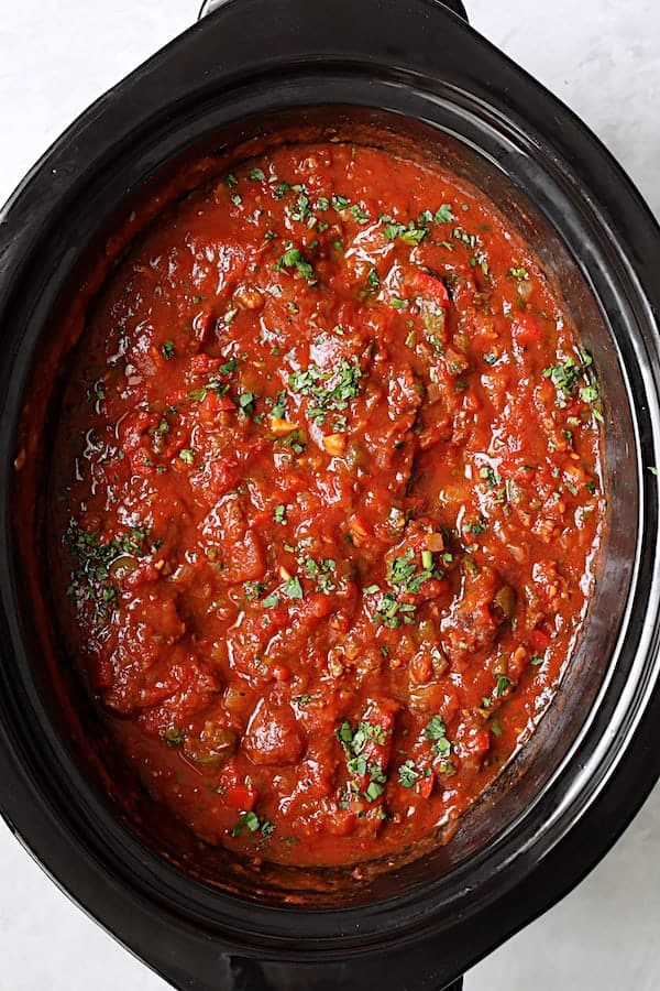 Photo of Slow Cooker Spicy Sausage and Pepper Ragu in the slow cooker.