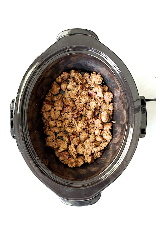 Photo of cooked Italian sausage in slow cooker.