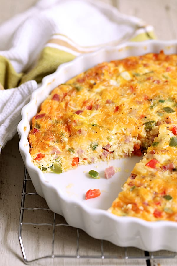 Close-up photo of the interior of Spicy Baked Denver Omelet in white quiche pan.
