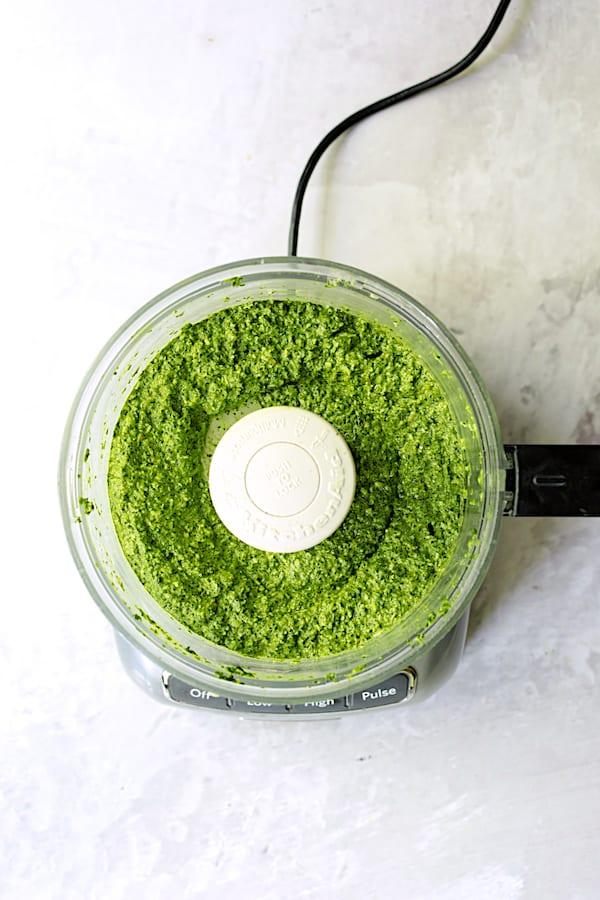 Overhead shot of spinach pesto in food processor