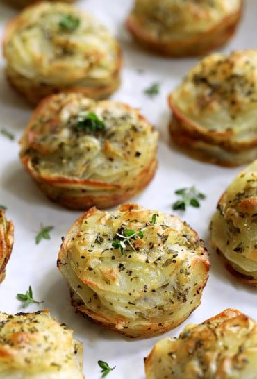 Garlic Herb Muffin Pan Potato Galettes - Straight-on hero shot on white background garnished with fresh thyme