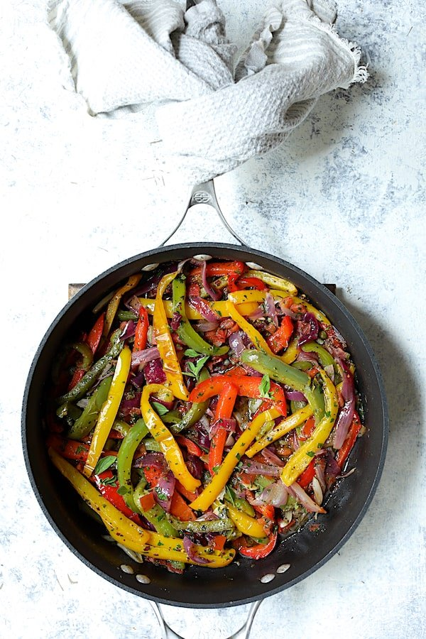 Overhead shot of peppers and onions in skillet