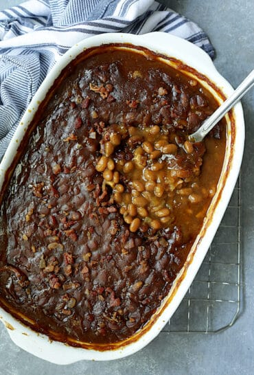 Kicked Up Canned Baked Beans - Overhead shot after spoon is inserted into the baked beans