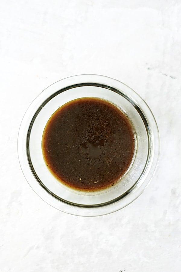 Overhead shot of honey balsamic dressing in white bowl