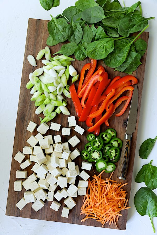 Photo of ingredients for Thai Yellow Curry with Crispy Tofu and Vegetables on wood cutting board.