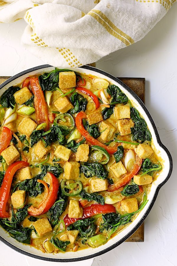 Thai Yellow Curry with Crispy Tofu and Vegetables - Overhead shot of finished curry in white skillet