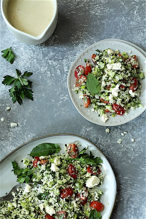 Photo of Cauliflower Tabouli with some served on small plate.