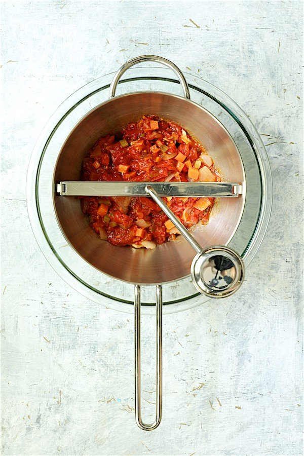 Sauce ingredients being processed in food mill