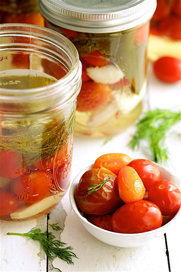 Pickled Grape Tomatoes - Shot of jar opened up with tomatoes in small white bowl
