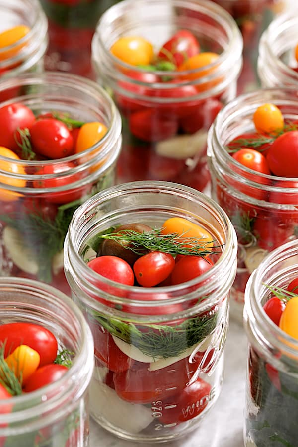 Grape tomatoes in glass pint jar before brine is added