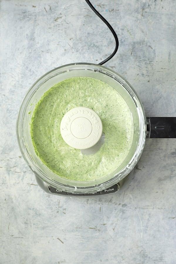 Overhead shot of cilantro yogurt sauce in food processor
