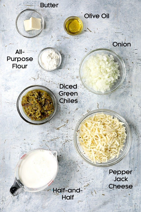 Photo of the ingredients for Au Gratin Potatoes with Green Chiles in glass bowls.