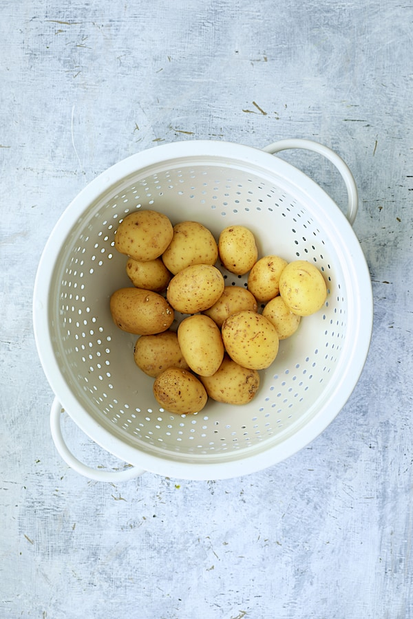 Overhead shot of potatoes in white colander