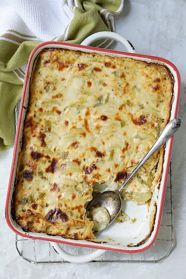 Au Gratin Potatoes with Green Chiles - Overhead hero shot with some of the potatoes removed
