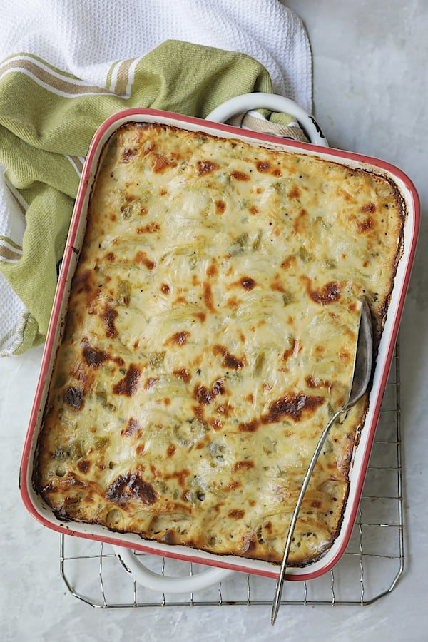 Au Gratin Potatoes with Green Chiles - Overhead shot of dish on white background