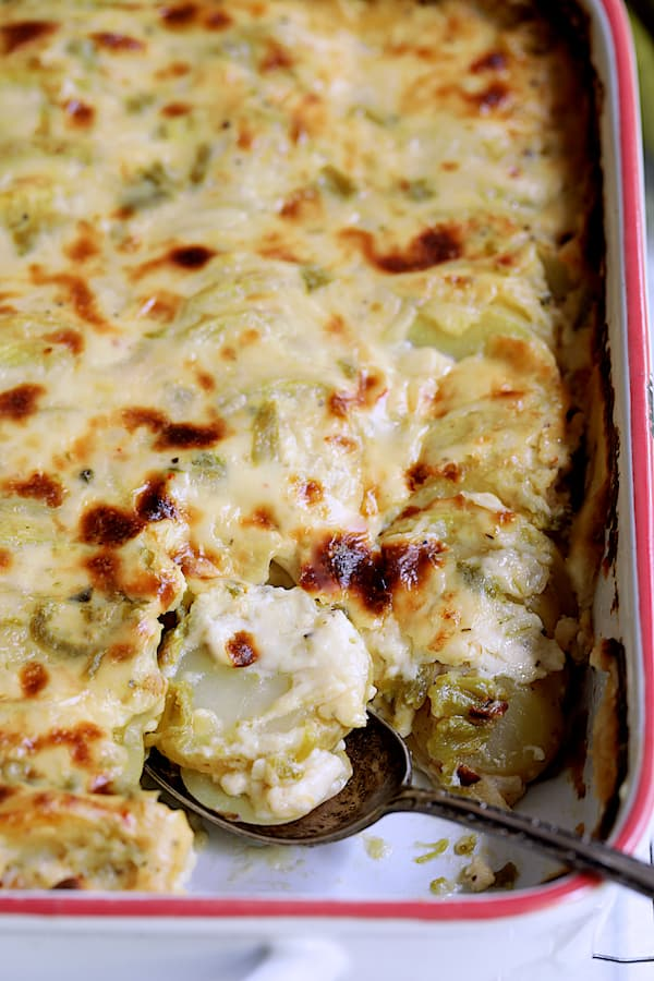 Au Gratin Potatoes with Green Chiles - Close-up shot of finished dish with some removed by spoon