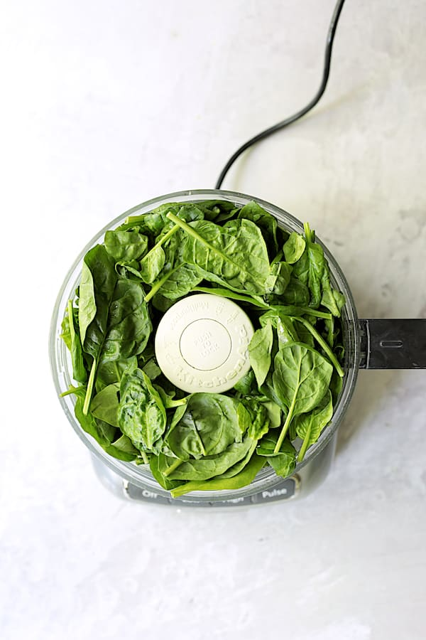 Overhead shot of spinach leaves in food processor