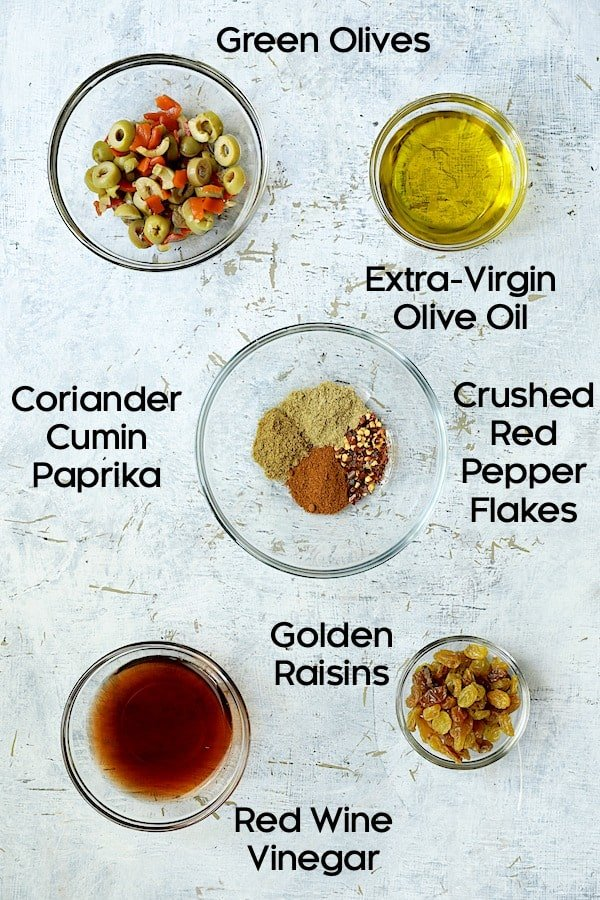 Photo of pantry ingredients for caponata in glass bowls.