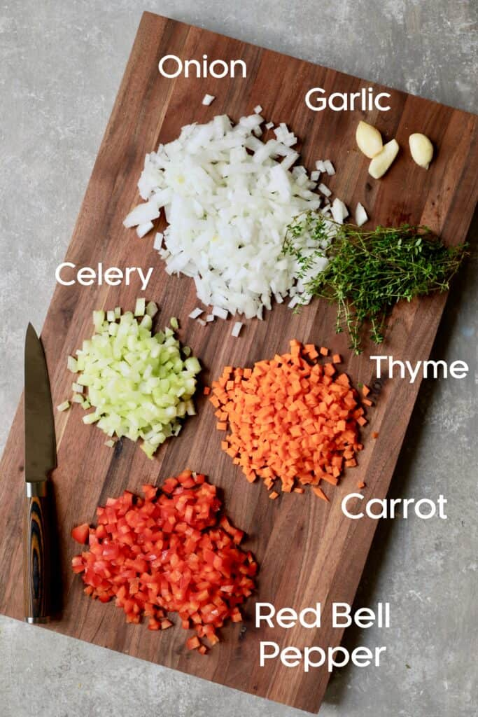 Photo of cut vegetables on wood cutting board.
