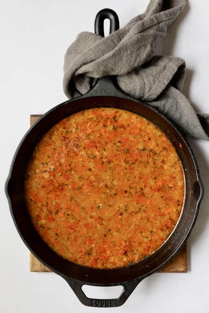 Overhead shot of Cajun sauce in cast iron skillet