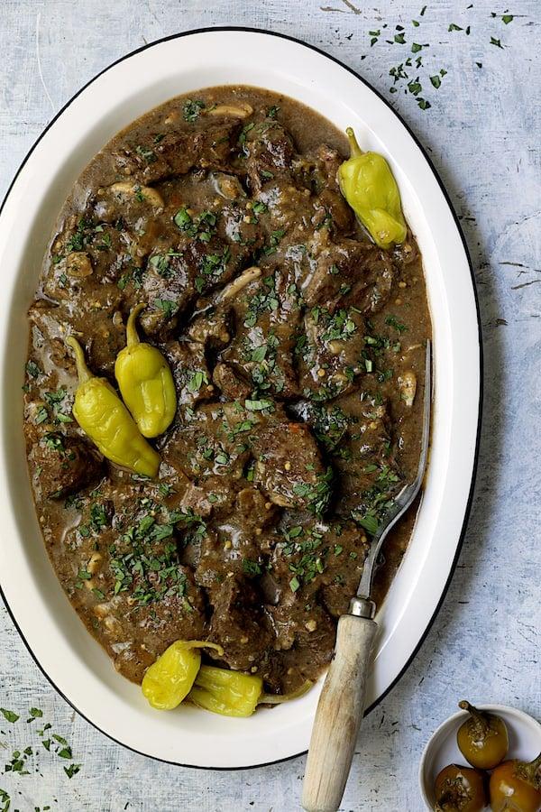 Mississippi-Style Boneless Short Ribs on white platter with meat fork
