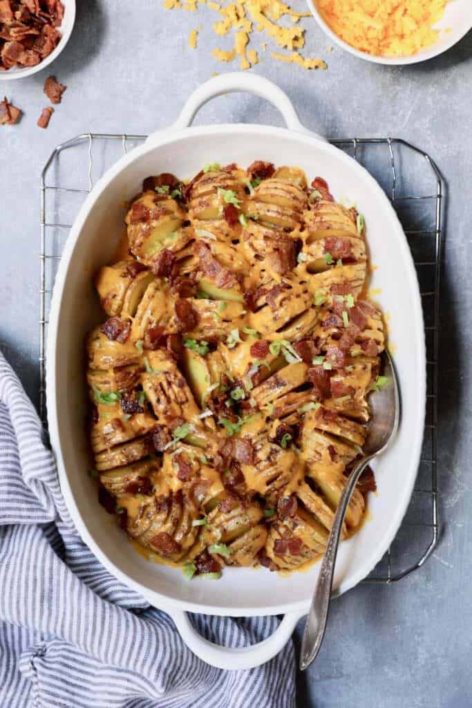 Baby Hasselback Potato Bake with Cheddar and Bacon - Overhead hero shot in white baking dish