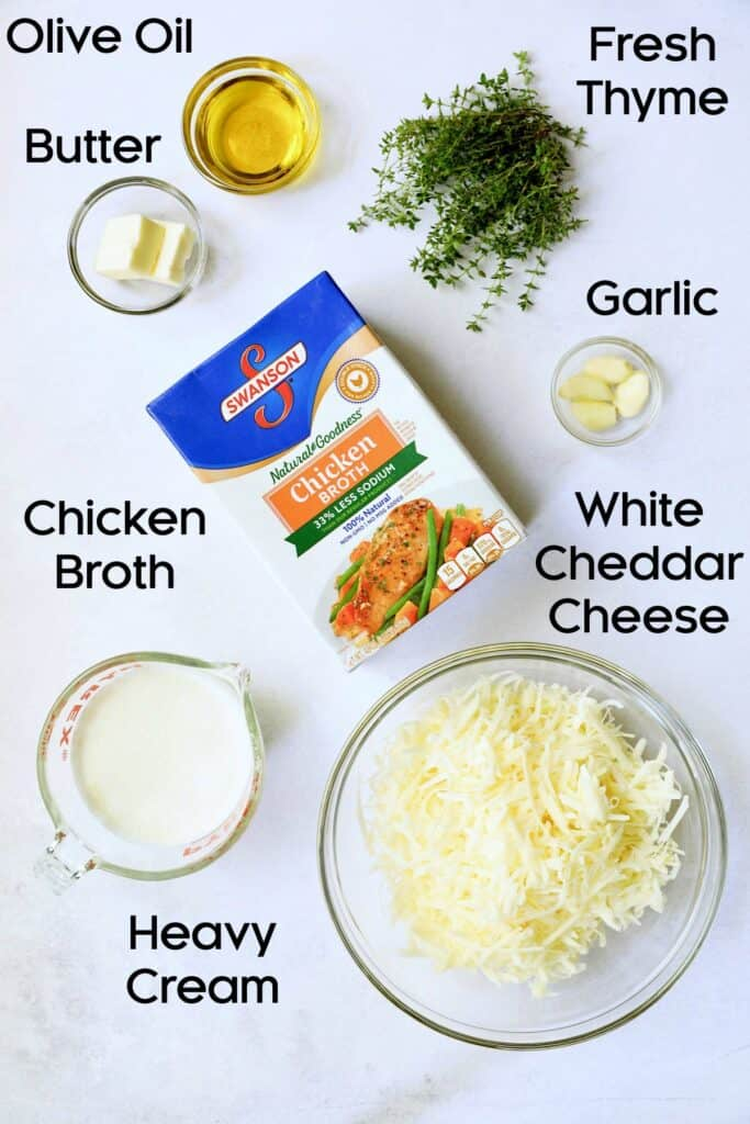Photo of ingredients for Potato Leek Soup with White Cheddar in glass bowls.