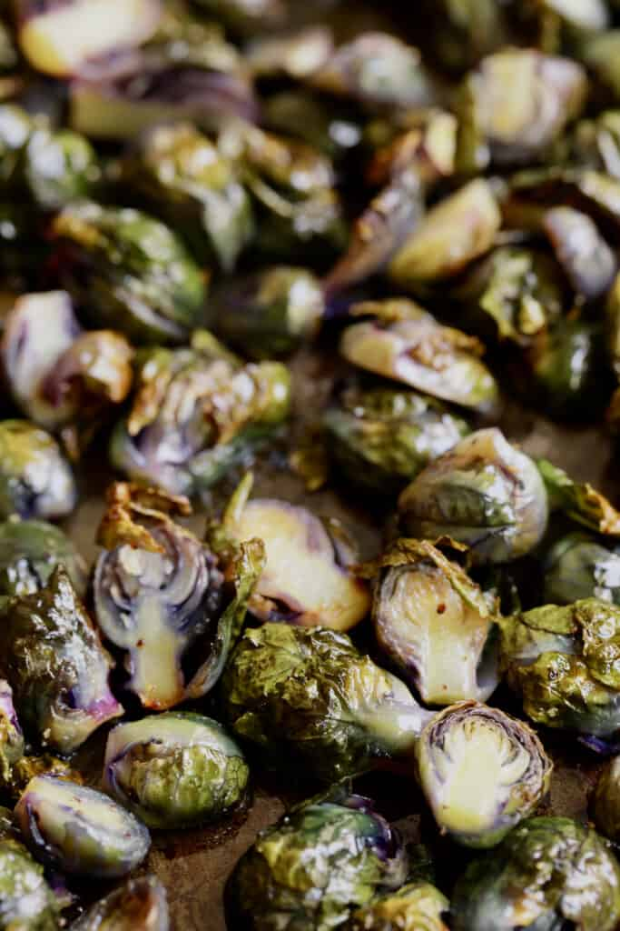 Close-up photo of roasted purple Brussels Sprouts.