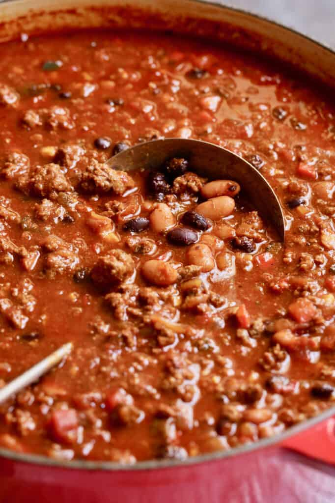 Chipotle Beef and Bean Chili - Close-up shot of finished chili in red Dutch oven