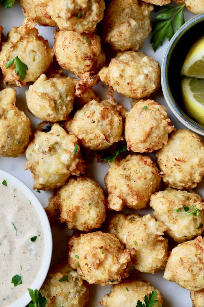 Close-up photo of Crab and Artichoke Beignets with Jalapeno Remoulade.