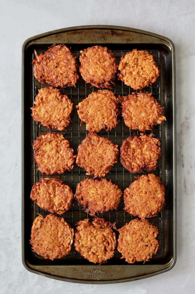 Overhead shot of fritters set on rack over baking sheet
