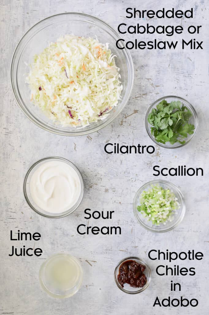 Overhead shot of ingredients for slaw in glass bowls
