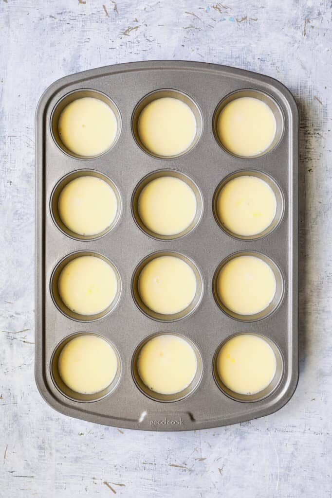 Photo of egg and milk combination in muffin pan.