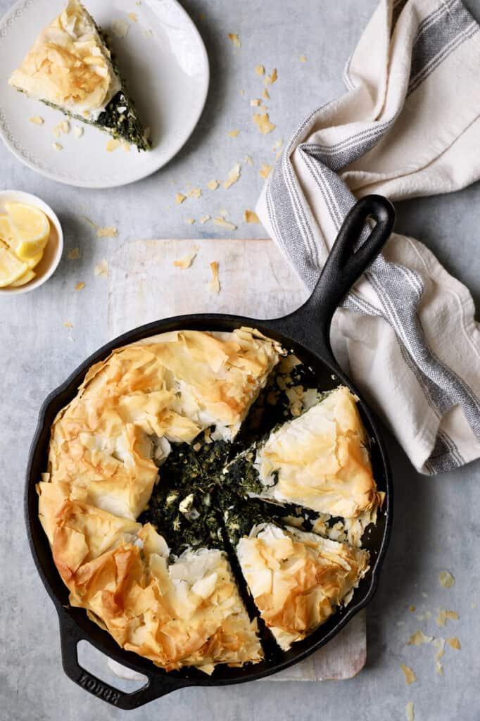 Skillet Spanakopita (Greek Spinach and Feta Pie) - Overhead shot of baked spanakopita on light gray background