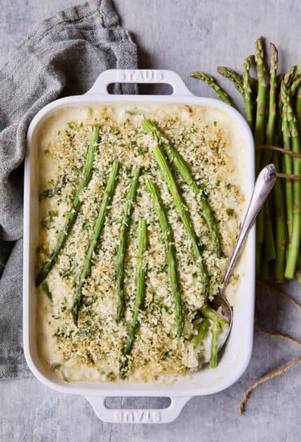 Photo of Creamy Asparagus and Rice Casserole with gray napkin.