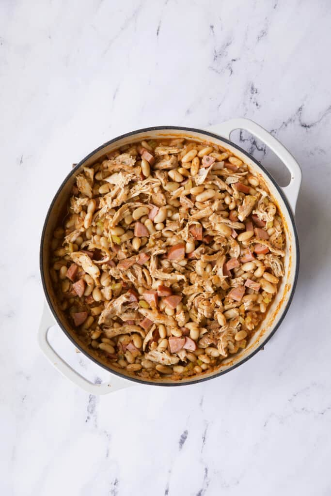 Photo of cassoulet on white marble surface before breadcrumbs are added.