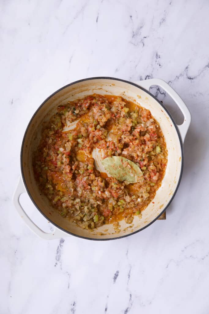 Photo of cassoulet after wine and tomato paste has been added.