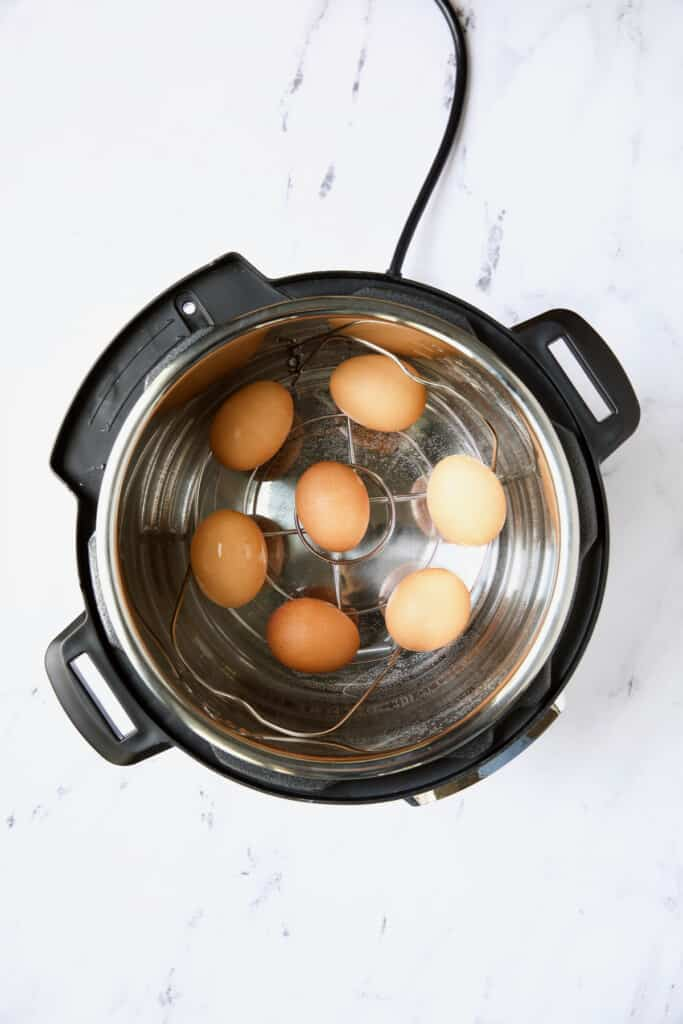 Photo of seven eggs in Instant Pot.