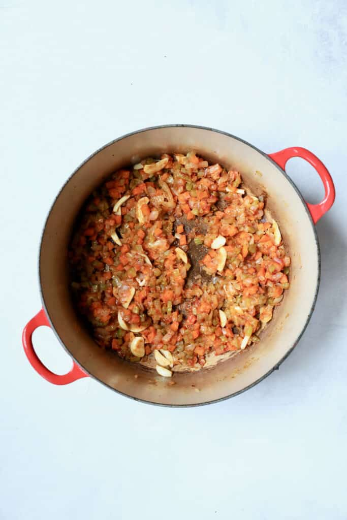 Photo of cooked onions, celery and carrots with flour and tomato paste added.