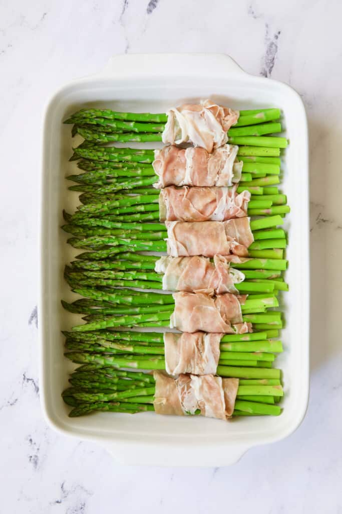Photo of bundles of asparagus wrapped in prosciutto.