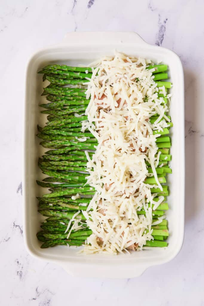 Photo of asparagus covered with Gruyere cheese.