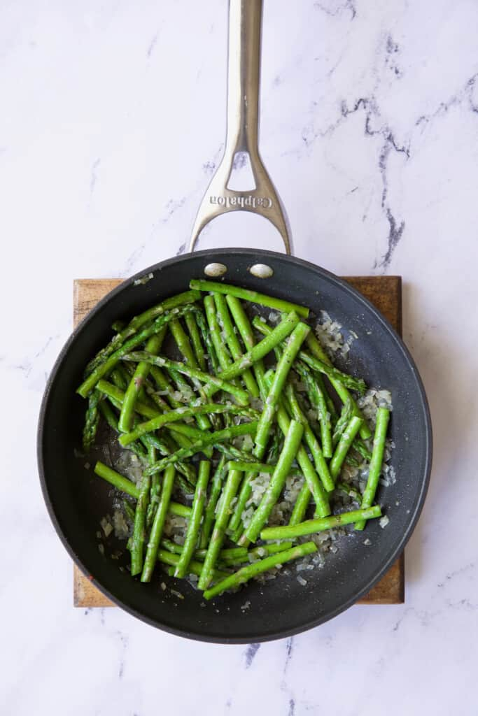 Photo of sauteed asparagus in nonstick skillet.