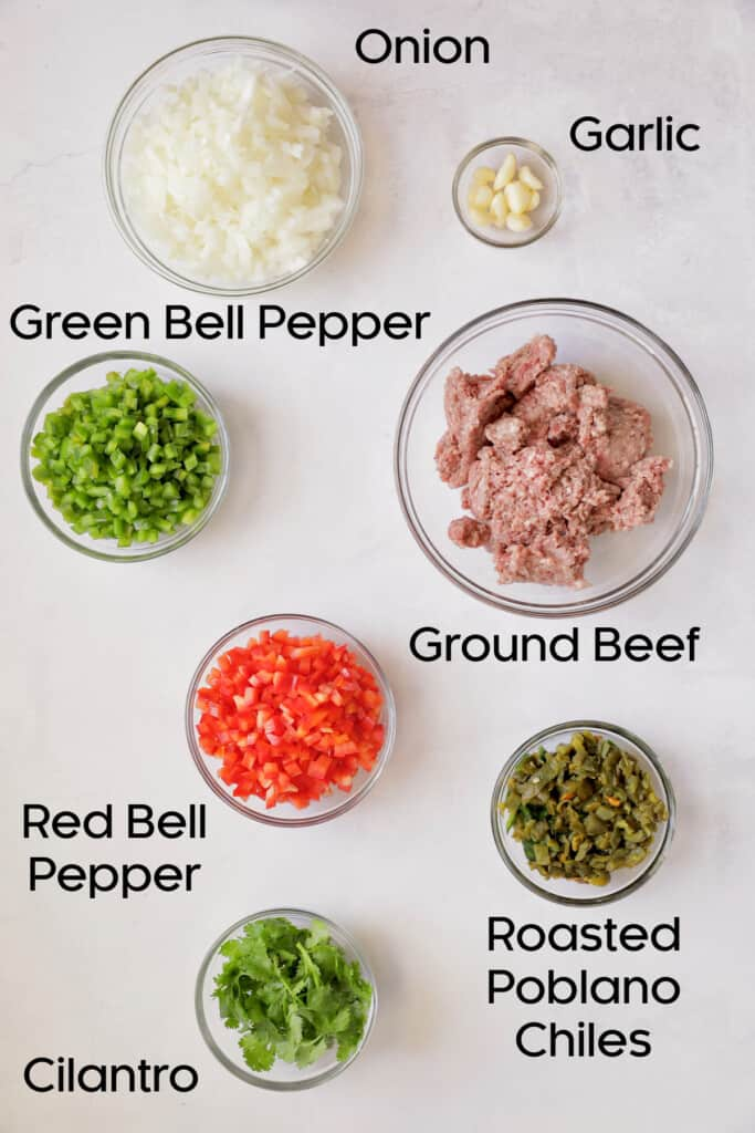 Photo of fresh ingredients for Southwestern Stuffed Pepper Soup in glass bowls.