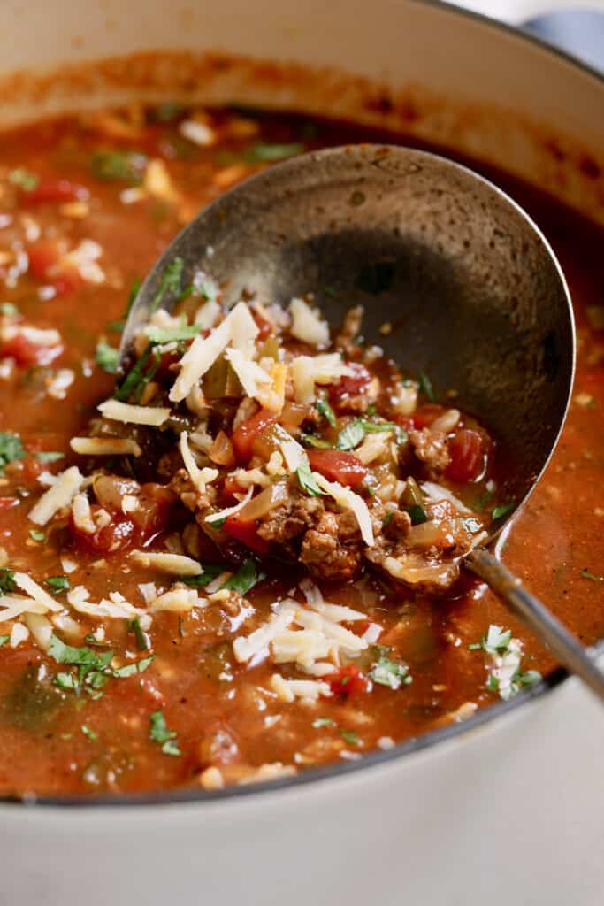 Close-up photo of a ladle scooping up Southwestern Stuffed Pepper Soup.