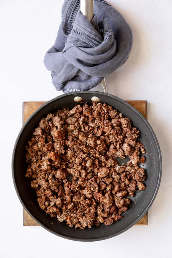 Photo of cooked and browned ground beef in nonstick skillet.